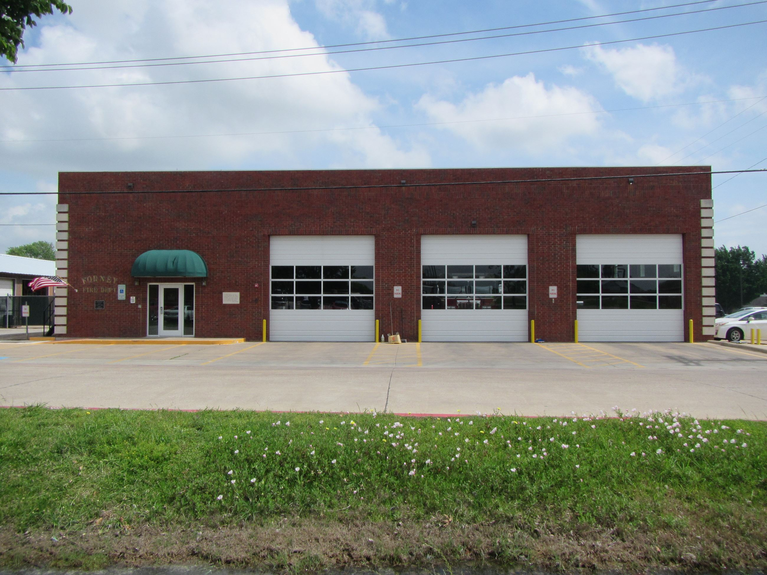 Brick Fire Station with Three Large Garage Doors